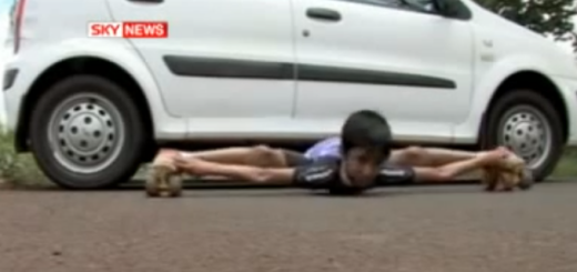 Indian boy limbo skate under four cars